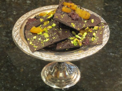 Silver dish of French Chocolate Bark topped with dried apricots, pistachios and dried cherries.