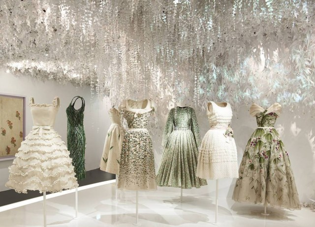 An assortment of white and cream Dior gowns.