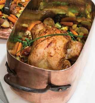 Chicken and vegetable in a copper pot.