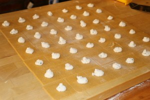 Pasta cut and filled for tortelloni.