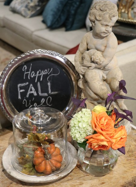 Fall decorations and a sign that says happy fall y'all!