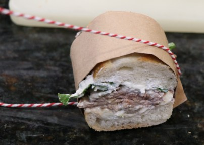 small sandwiches tied with string