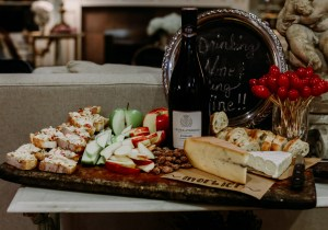 Cheese board with apples and wine