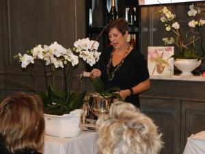 Julie O'Keeffe arranging orchids