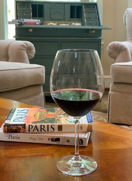 glass of wine and books