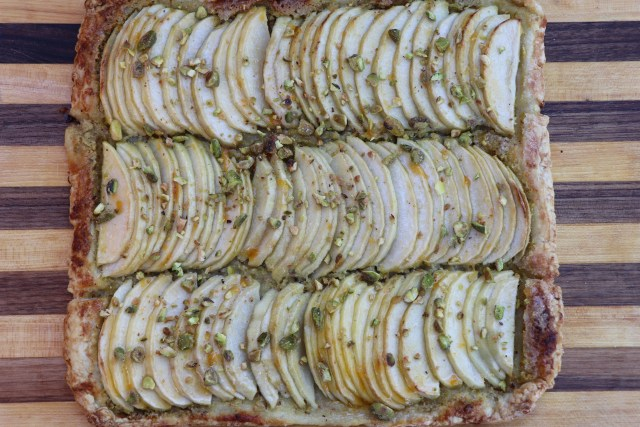 Apple pistachio tart recipe, ready to cut and serve.