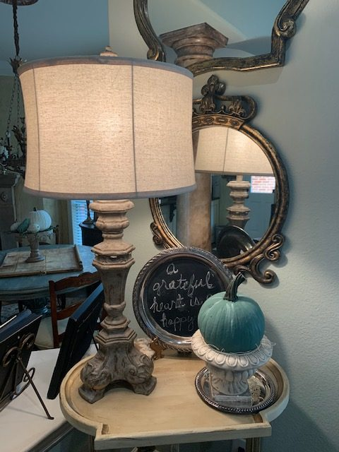 Fall decorating with pumpkins painted teal and white.