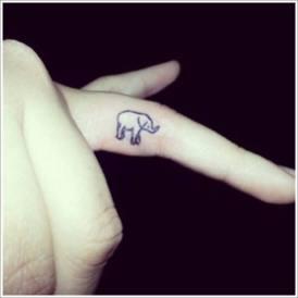 08 Small Elephant Tattoo on finger