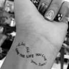 20 Love life lettering wrist tattoo