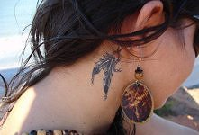 feathers tatoo behind aer