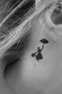 girl with umbrella tattoo behind ear