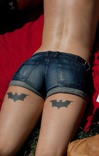 Batman tattoo on the back of a thigh http://www.3d-tattoodesign.com/hebrew-lettering-body-thigh-tattoo-designs-women/
