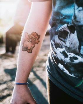 Cute Vulpix tattoo on arm