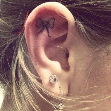 Cute ribbon tattooed on earlobe http://www.cuded.com/2014/05/55-incredible-ear-tattoos/
