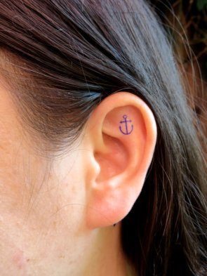 Cute small anchor tattoo on ear http://fresh-tattoos.com/anchor-tattoos/cute-anchor-tattoo-behind-ear