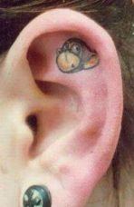 Cute and unusual monkey tattoo on ear
