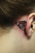 Here he is :D Hiding behind her ear http://www.cuded.com/2014/05/55-incredible-ear-tattoos/