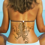 Octopus Tattoo on Lower Back http://www.buzzle.com/articles/5amazing-octopus-tattoo-design-ideas.html