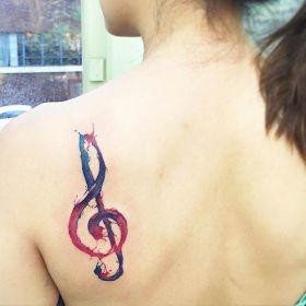 Stunning reddish-purple design. Instagram / tattoojune. http://stayglam.com/life/51-watercolor-tattoo-ideas-for-women/2/