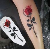 Rose tattoo on the lower arm