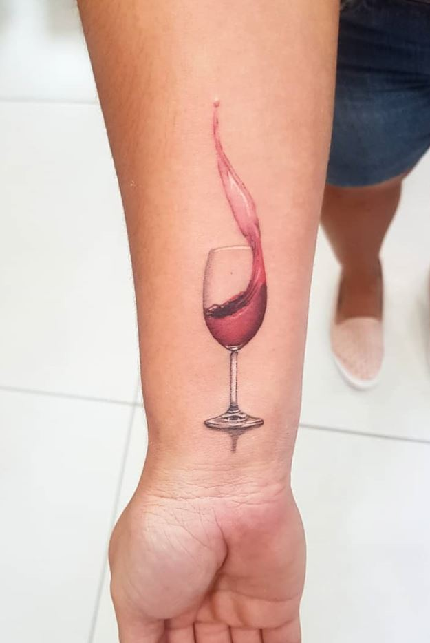 Amazing glass of wine tattoos on forearm