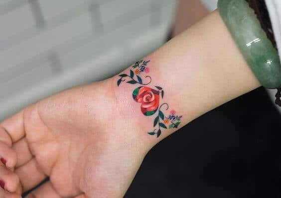 Flower and heart armband tattoos ideas for women