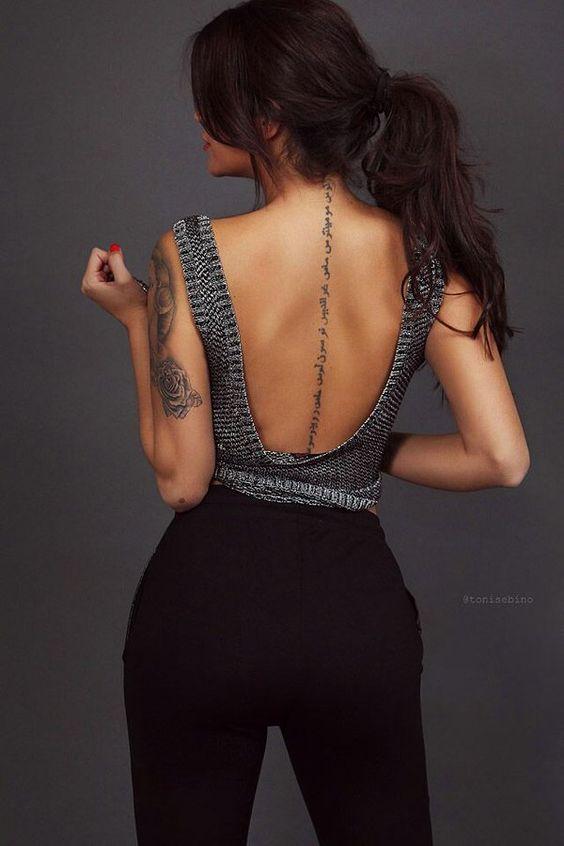 Beautiful back spine women's tattoo design
