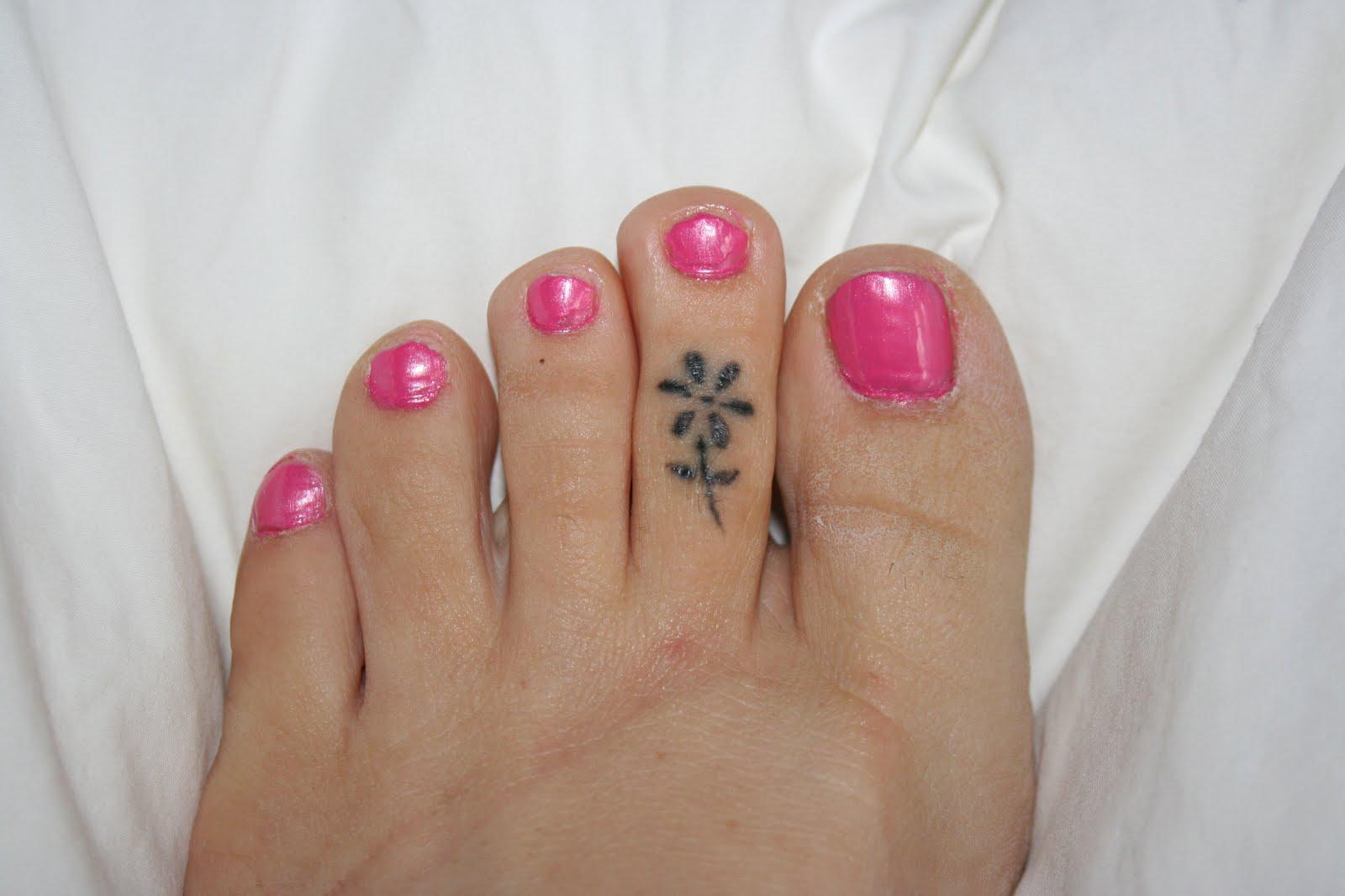 Flower tattoo on women toe