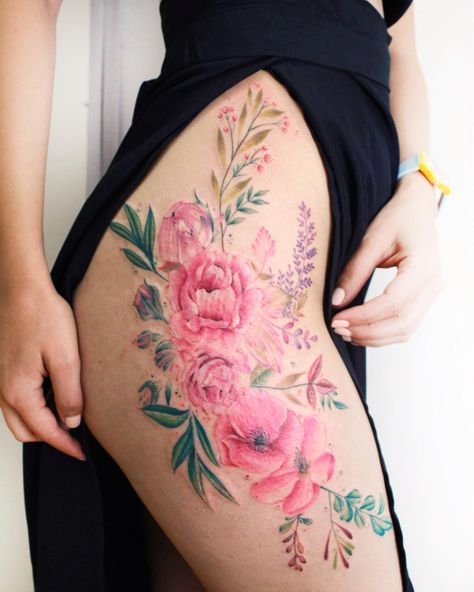 Meaningful flower thigh tattoo for women