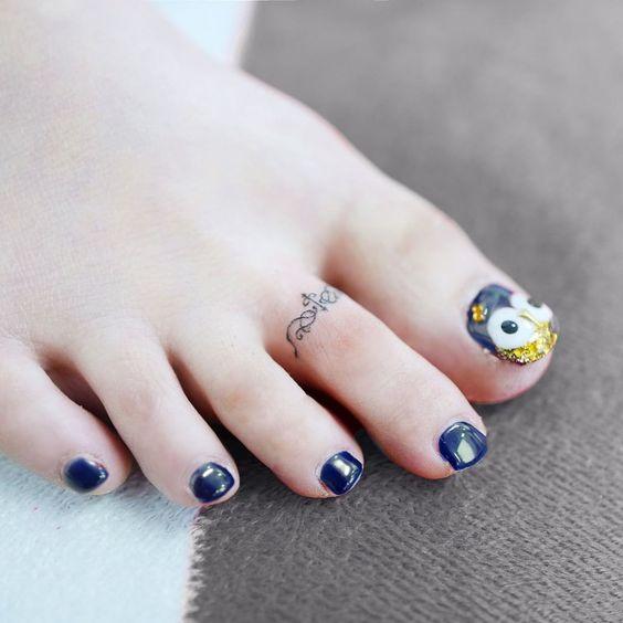 Minimalist toe tattoo for women
