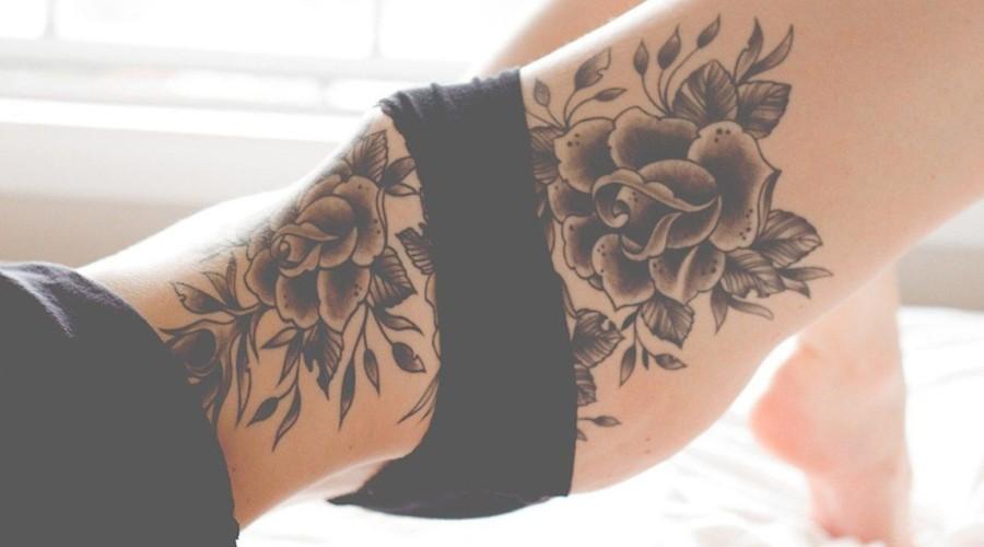 Unique women thigh flower tattoo