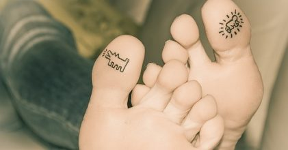 Dog tattoos under big women toe