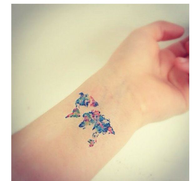 Gorgeous and colorful world map tattoo on wrist