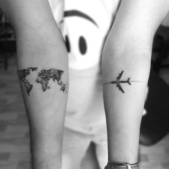 Map of the world and flying plane tattoo for women ideas