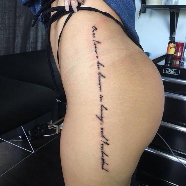 Original long vertical script on hip tattoo