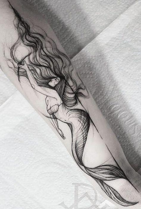 Black and white mermaid tattoo on arm