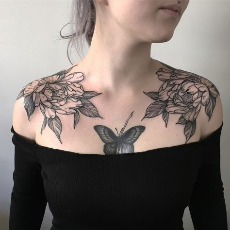 Subtle moth tattoo design on chest