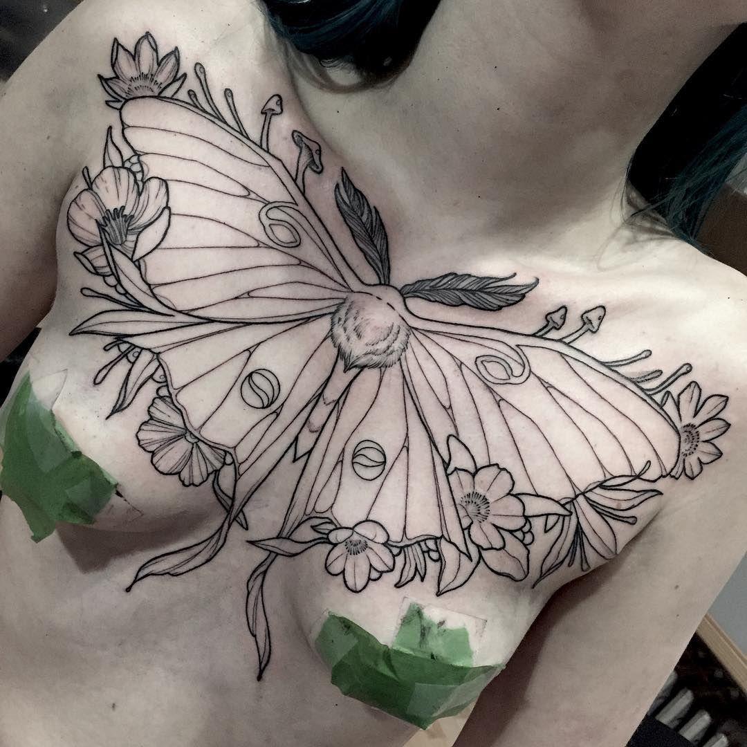 Unique moth tattoo on chest