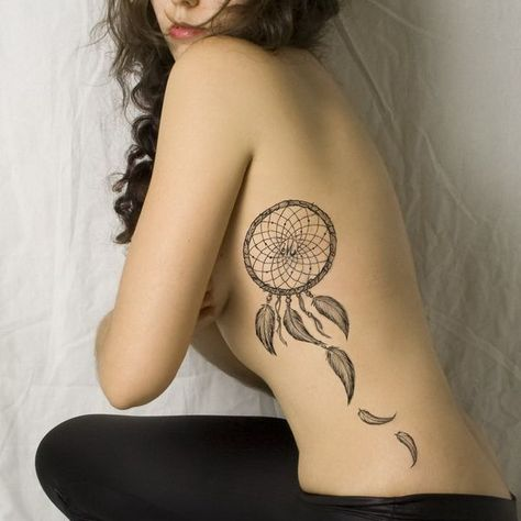 With style dream catcher on ribs tattoo