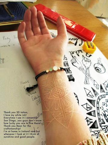 Cool white ink tattoo design on forearm