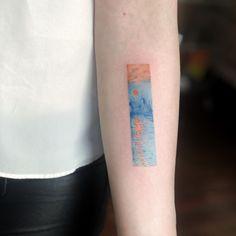 Monet sun set tattoo on forearm
