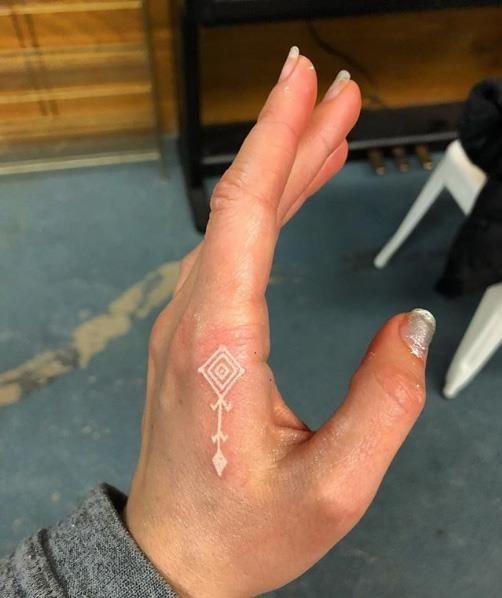 Talizman white ink tattoo on hand