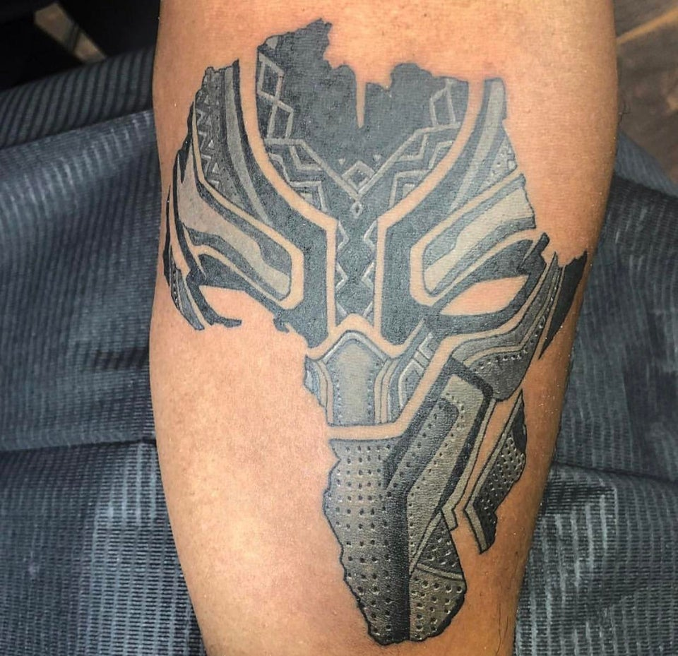Black Panther in shape of Africa tattoo