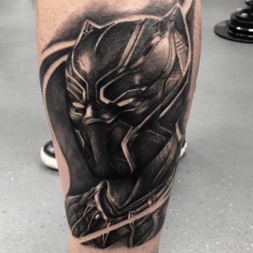 Calf tattoo of black panther's face