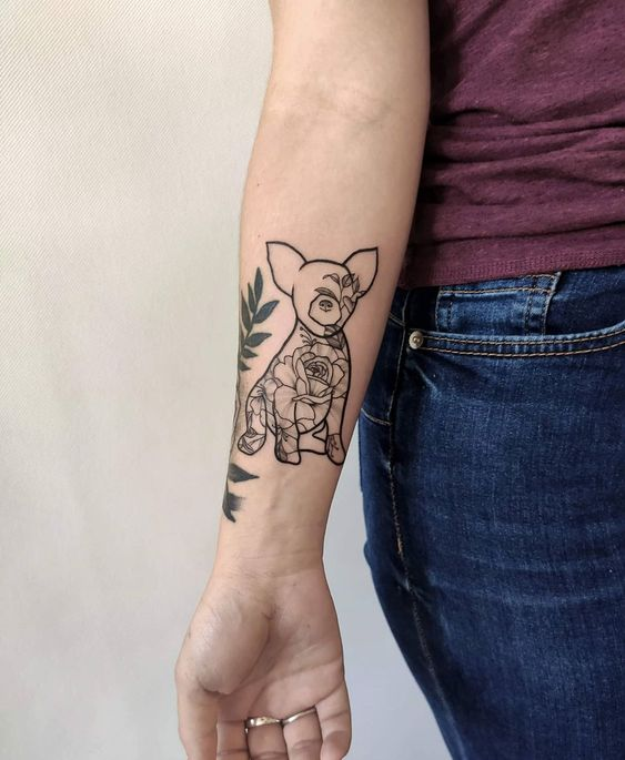 Dog lovers tattoo on forearm