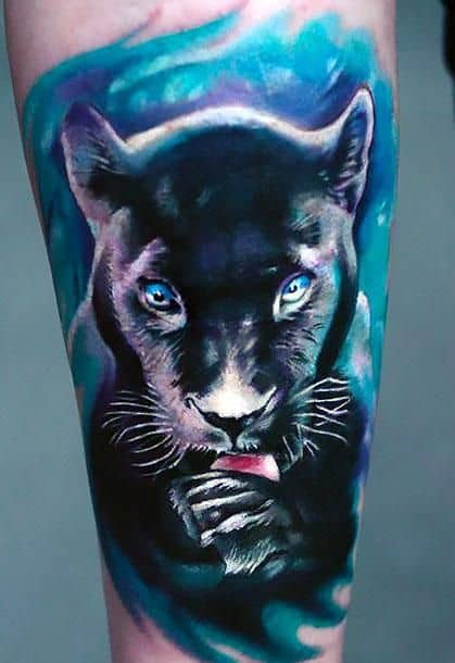 Realistic black panther tattoo on arm