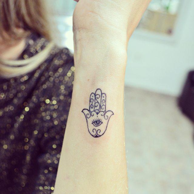 Cute hamsa hand tattoo for girl