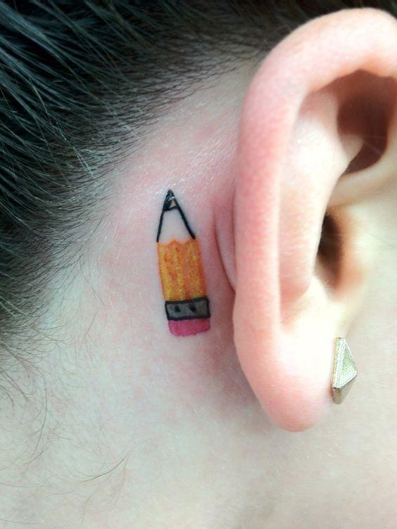 Cute pencil tattoo behind the ear