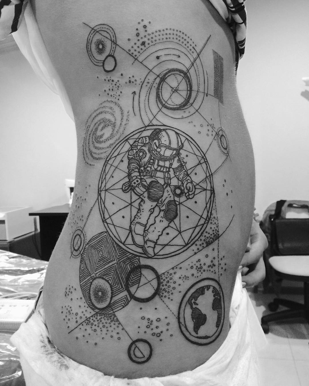 Geometric solar system tattoo on side
