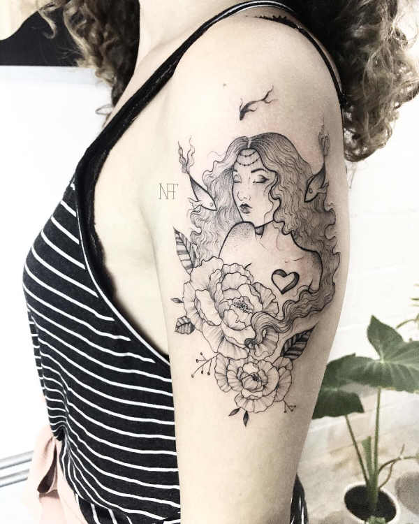 Lady and pisces tattoo on arm
